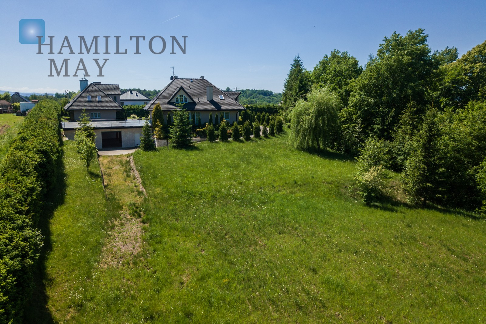 An impressive residence located in a picturesque corner od Konary, featuring 2 modern houses and commercial property Krakow for sale
